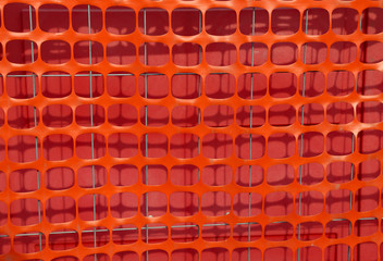 orange plastic protective net for delimiting the area of a build