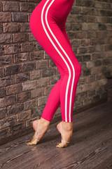 Detail of woman dancer feet in pointe, ballerina wear in modern sportswear.