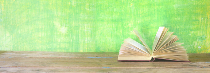open book on green grungy background, good copy space