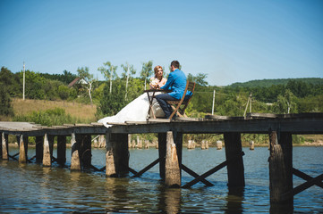 Couple at Picnic on Bridge