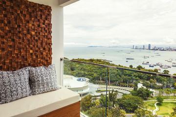 Balcony interior design and condo view of skyline Pattaya Beach, Thailand