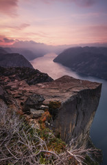 A river running through a mountainous landscape at dawn.