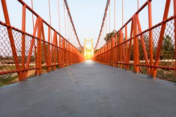 Red Suspension bridge, Crossing the river