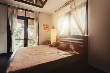 Bed room with balcony villa interior