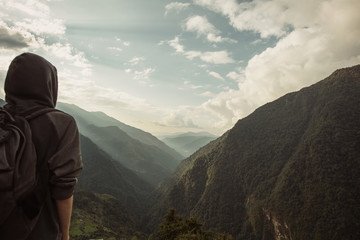Man Hiker on a top of a mountain. Success, freedom and happiness, achievement in mountains. Himalayas. Nepal