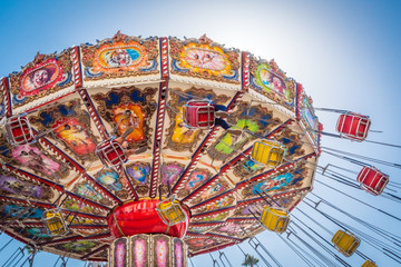 A colorful fair swinging ride.