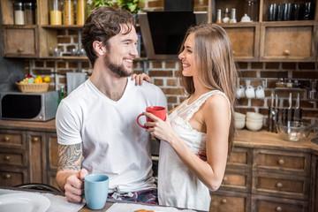 Happy couple drinking tea