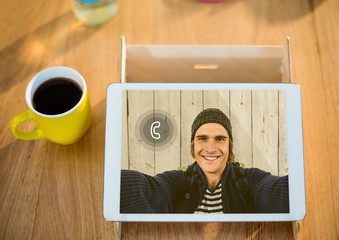 Digital tablet displaying man on video calling screen