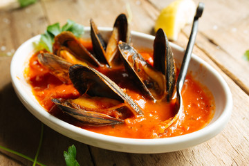 Mussel dish cooked in red marinara sauce