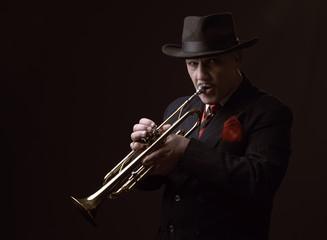 Fotobehang Muziekband Mature Jazz man playing a trumpet