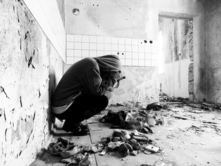Sitting women in depression, young sadness women crying in old dirty abandoned house