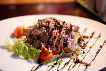 Meat salad with beef tongue and vegetables