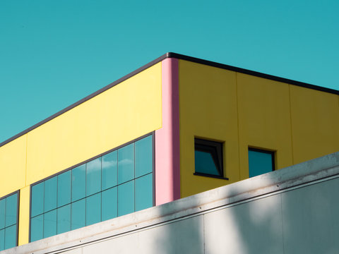 Bold yellow building against blue sky