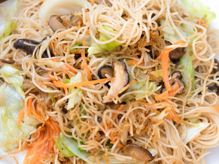 Vintage style Thai traditional food Chinese fried noodle vegan food on top able on wooden background wallpaper