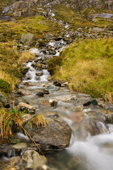 A small mountain stream on the Cwm Idwal track in the Snowdonia National Park in North Wales. Shot with a long exposure to accentuate the flow of the water