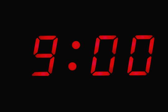 Digital clock displaying nine o'clock