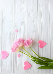 Wooden white background and pink tulips.  March 8, Mother's Day.