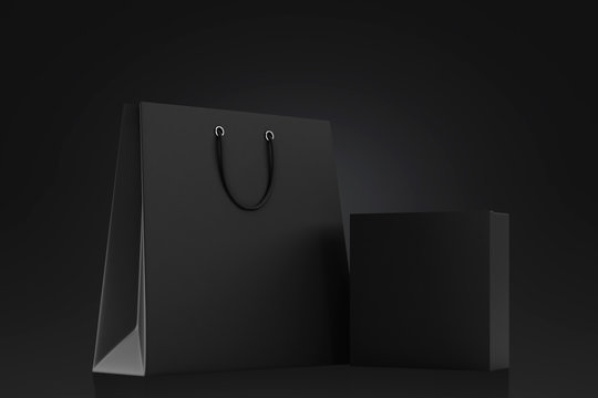 Black shopping bag and blank box on a black background. Mock up. 3d rendering