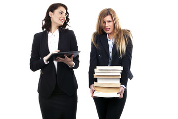 beautifull office secretaries with their E-Book and Books  working - E-book easy and heavy Books