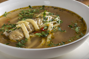Chicken soup with noodles and herbs