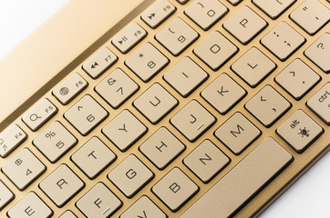 Gold keyboard on a white background