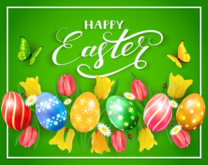 Easter eggs and flowers on green background