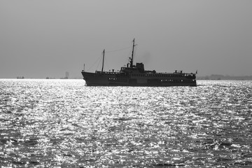 black-and-white photo of boats in the sea of Marmara in the backlight