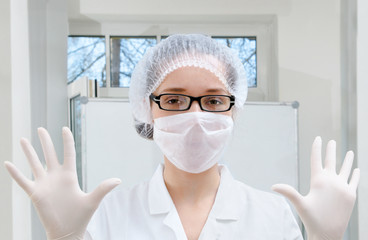 Lab worker demonstrates protective wear