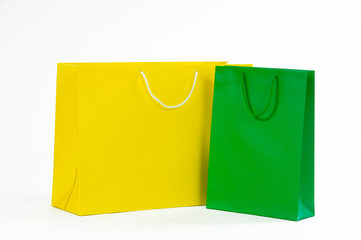 Yellow and green paper bag on a white background.