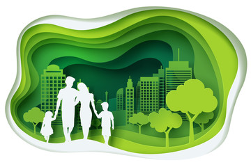 Paper carve to family and park on green town shape, paper art concept and ecology idea