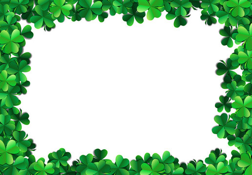Saint Patricks day background with sprayed green clover leaves or shamrocks