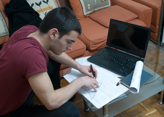 Photographing Danila Mazić in a tight red shirt and black pants while drawing construction plans, Novi Sad, Serbia