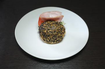 Ham and cheese black mini hamburger on black background  , mini burgers with ham and vegetables
