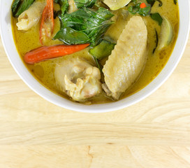 green curry chicken on wood table. Thai cuisine