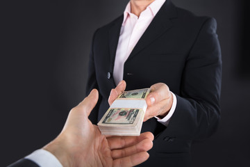 Businessman Receiving A Bank Note