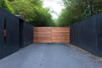Sliding driveway door with iron and wooden panel