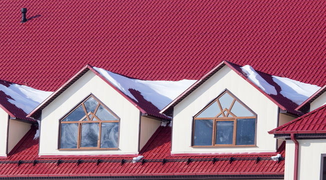 snow on the red house roof