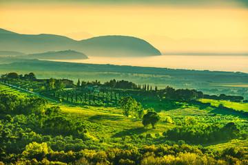 Maremma sunset panorama. Countryside, sea and Elba on horizon. San Vincenzo, Tuscany, Italy.