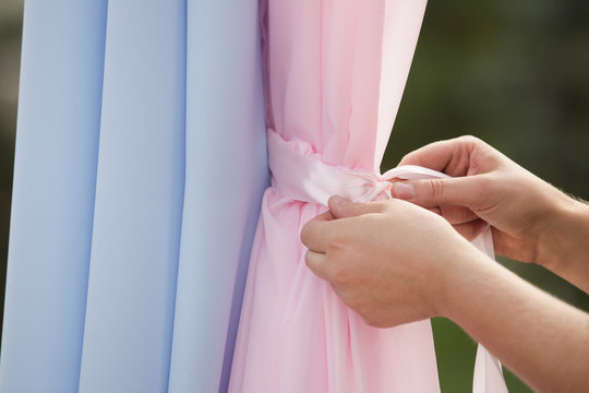 Close-up of the hands of the designer, decorating the venue of the celebration.