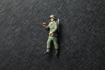 An old and dirty plastic soldier miniature model represent the soldier model toy and hobby concept related idea.