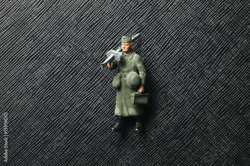 An old and dirty plastic soldier miniature model represent the