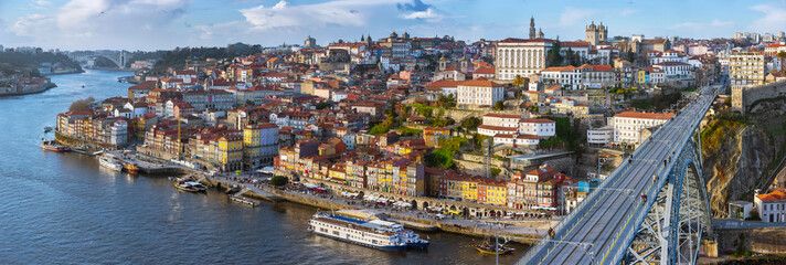 Wide angle Panorama of old town Porto, Portugal. Douro river and the Dom Luis Bridge.