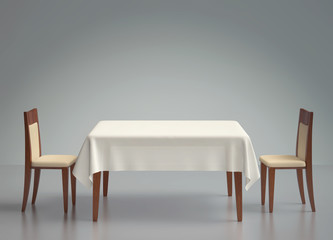 Wooden table with tablecloth and two chairs