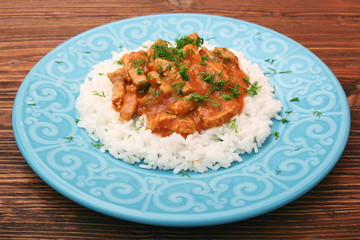 Rice with meat in tomato sause