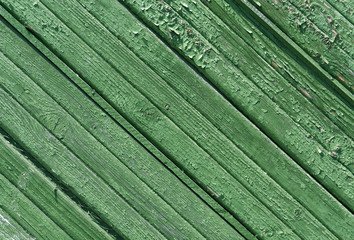 Weathered green wood house wall