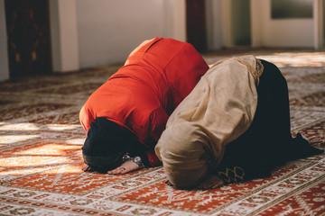 Muslim women praying together