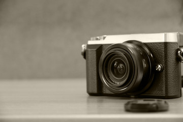Mono-tone vintage camera on the table.