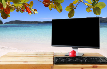 Workspace and monitor on Beach