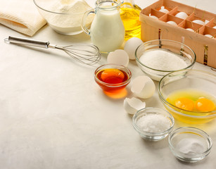 Ingredients for making pancakes on a white background. Copy space.