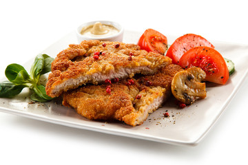 Fried pork chop with mushrooms and vegetables